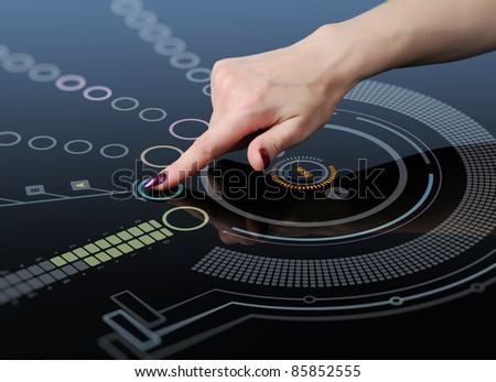 Hand pushes a button on the touch screen interface, the glass, technology concept - stock photo