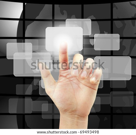 hand pushing a button on a touch screen