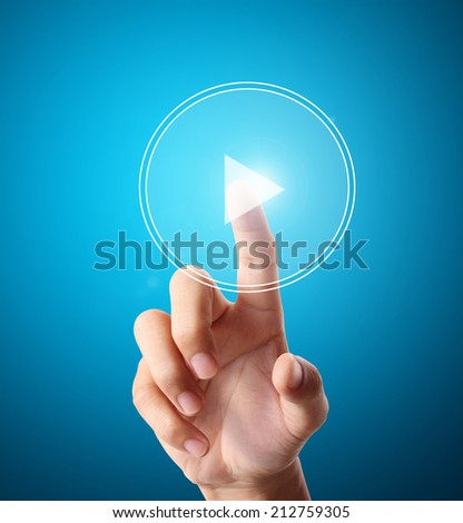 hand pushing a button on a touch screen interface  - stock photo