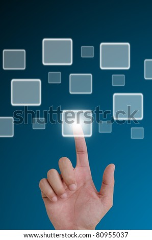 hand pushing a button on a touch screen interface. - stock photo