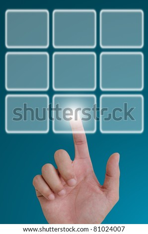 hand pushing a button on a touch screen interface.