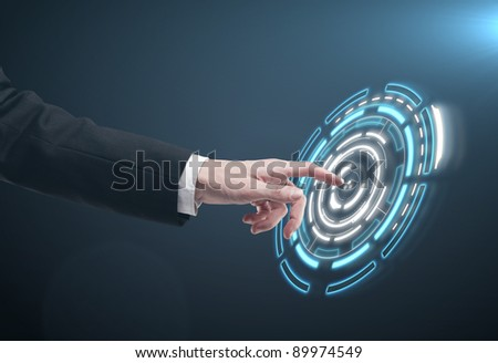 Hand pushing a button on a touch screen interface. Man pressing a touchscreen button - stock photo