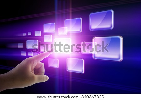 Hand pushing a button on a touchscreen interface - stock photo