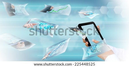hand pushing a button streaming images on a touch screen interface  - stock photo