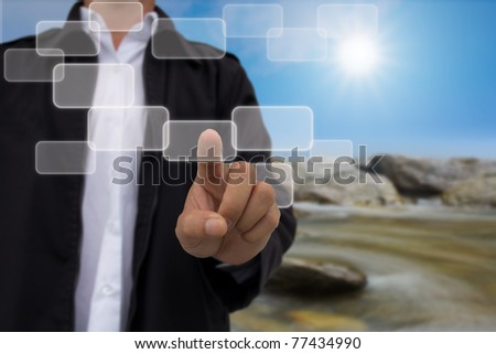 hand pushing a button touch screen