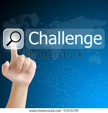 hand pushing a search button to find challenge word on a touch screen interface - stock photo