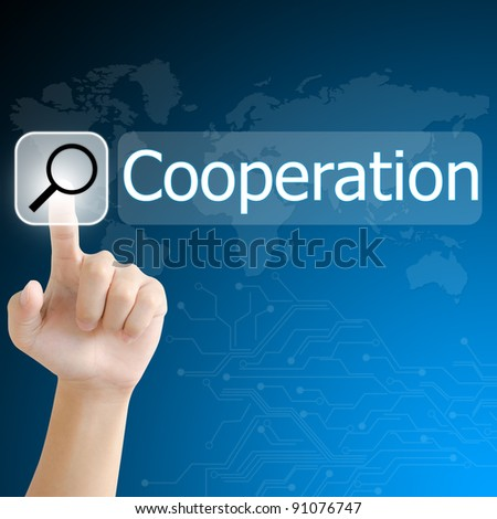 hand pushing a search button to find cooperation word on a touch screen interface