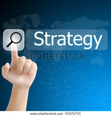 hand pushing a search button to find strategy word on a touch screen interface - stock photo