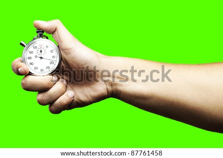 hand pushing a stopwatch button to stop it against a removable chroma key background - stock photo