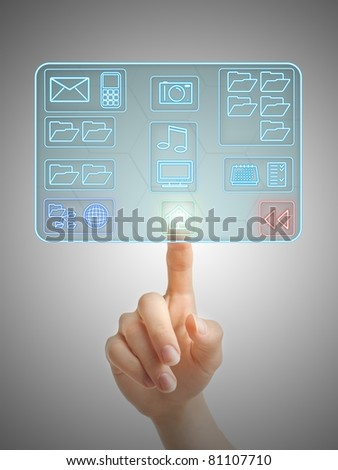 Hand pushing an icon on a futuristic holographic interface. - stock photo