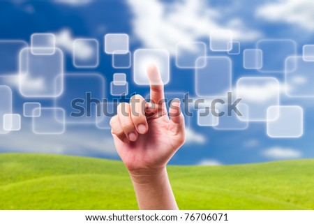 hand pushing button on blue sky