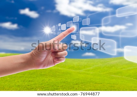hand pushing button on blue sky - stock photo
