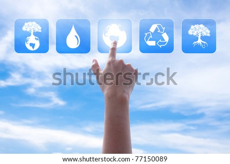 Hand pushing button over the blue sky - stock photo