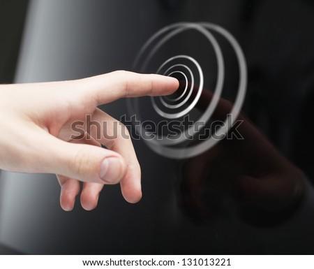hand pushing circle interface on screen - stock photo