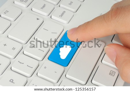 Hand pushing cloud computing button on keyboard