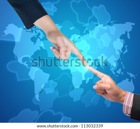 Hand pushing cook button on a touch screen interface - stock photo
