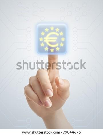 Hand pushing Euro button - stock photo