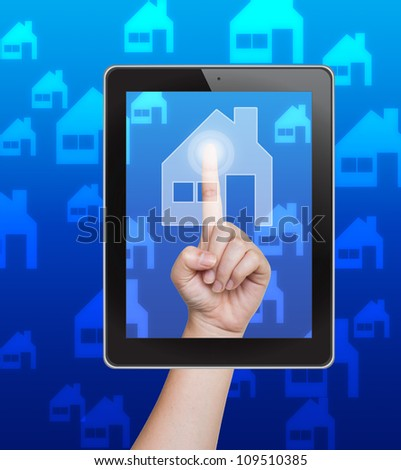 Hand pushing home button of tablet on a touch screen - stock photo