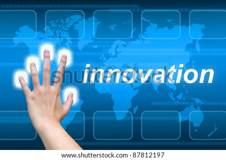 hand pushing innovation button on a touch screen interface - stock photo