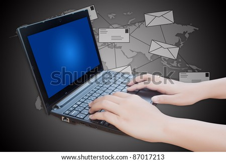 Hand pushing laptop keyboard with mail.