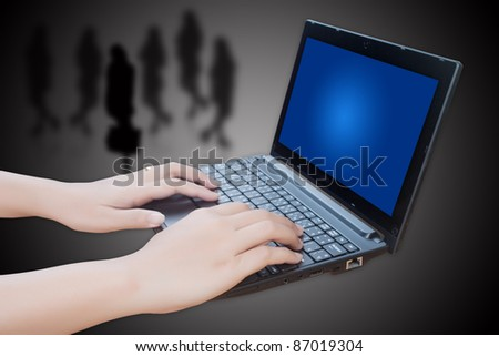 Hand pushing laptop keyboard with social network.
