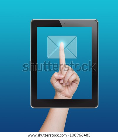 Hand pushing mail button of tablet on a touch screen - stock photo