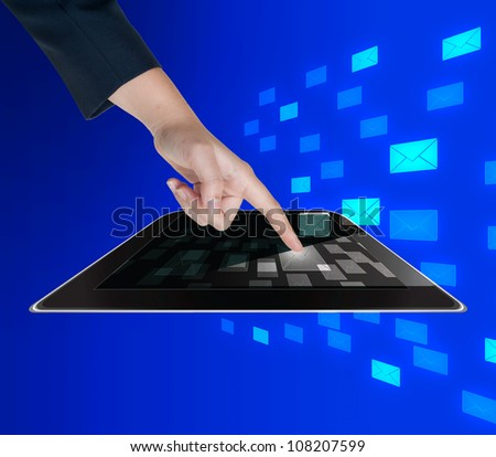 Hand pushing mail button of tablet on a touch screen interface - stock photo