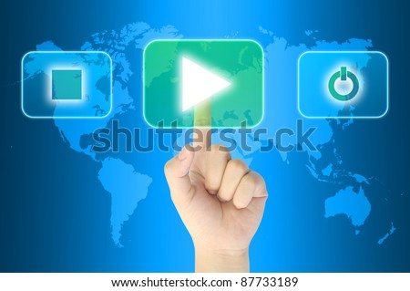 hand pushing media player technology button on a touch screen interface - stock photo