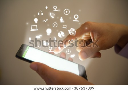 Hand pushing mobile phones ,social network technology