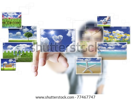 hand pushing on a touch screen interface - stock photo