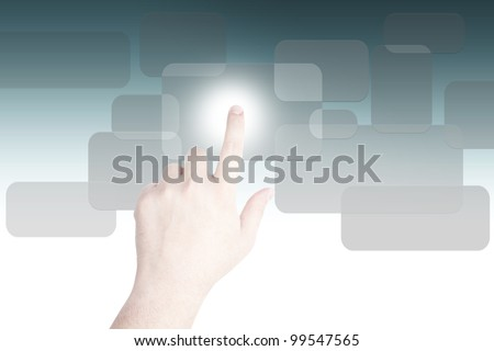 hand pushing on a touch screen on grey button