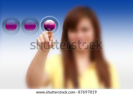 hand pushing on world Button - stock photo