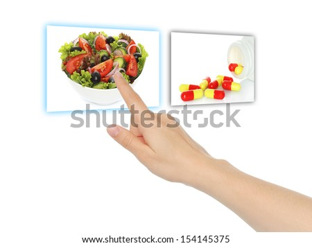 Hand pushing virtual salad instead of pills on white background - stock photo