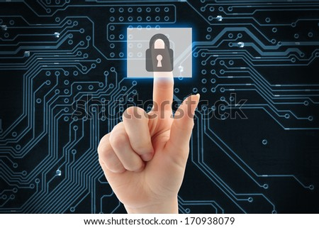 Hand pushing virtual security button on digital background  - stock photo
