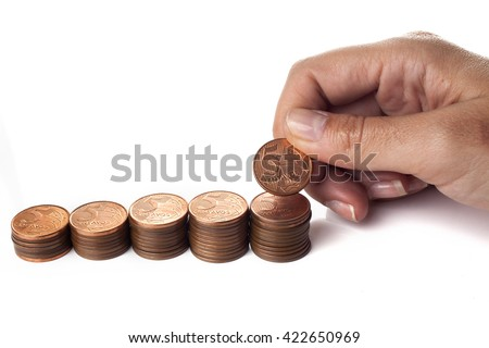 Hand put 5 cents coin to pile of brazilian coins (money) on white background - stock photo