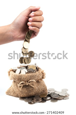 hand put coin in bag with money isolated on white, investment or growth concept - stock photo