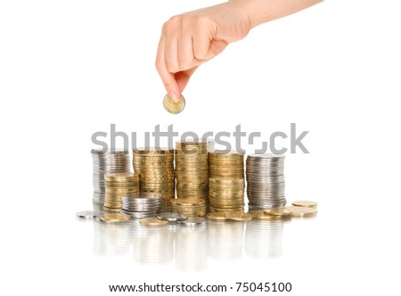 Hand put coin to money staircase with reflection - stock photo