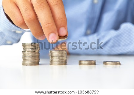 Hand put coin to stack, investment concept