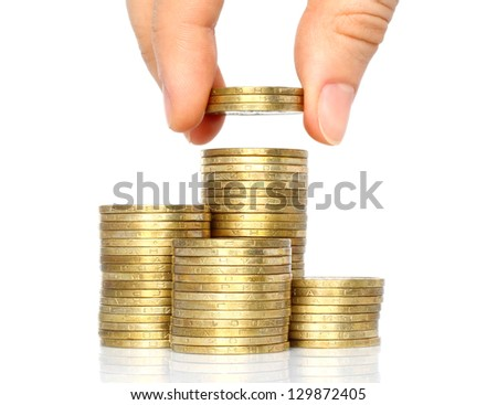 Hand put coins to stack of coins on white background - stock photo