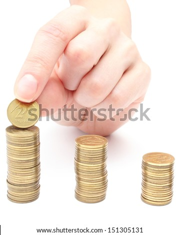 Hand put coins to stack of coins on white background