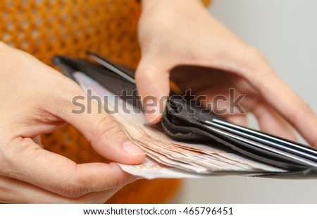 Hand put down money coin to growing bag with white background, finance concept, business background, money content, copy space and selective focus.