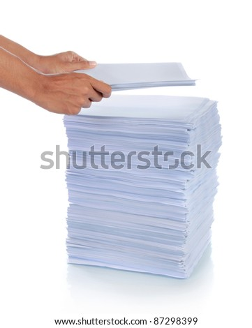 hand put paper on stack of paper. with isolated background - stock photo
