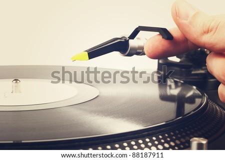 hand put the tonearm on vinyl record - stock photo