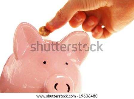 hand putting a penny into the piggy bank, on white - stock photo