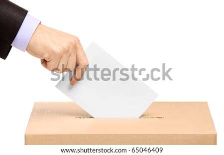 Hand putting a voting ballot in a slot of box isolated on white background - stock photo