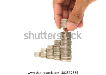 hand putting add money coin stack on white isolation background - stock photo