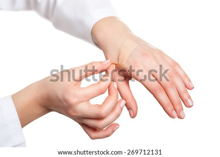 Hand putting adhesive bandage - stock photo