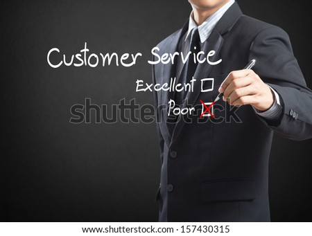 Hand putting check mark on poor customer service evaluation form - stock photo