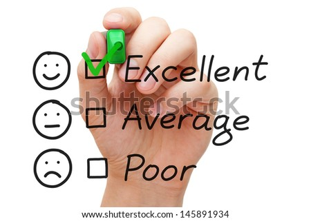 Hand putting check mark with green marker on excellent customer service evaluation form.