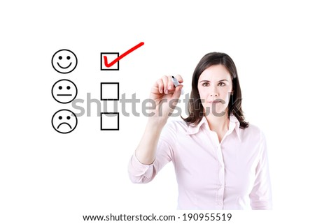 Hand putting check mark with red marker on customer service evaluation form.